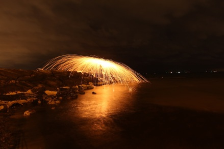 Fire spins in beach Partners in Light
