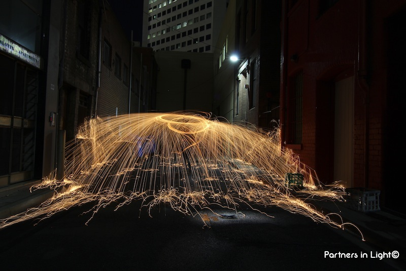 Partners in Light - Laneway horizontal sparks